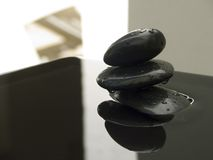 Zen rocks with shadow. Black zen rocks water with shadow Royalty Free Stock Image