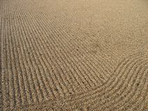Zen Sand 1. Sand grinding pattern in the temple grounds of Shintennoji, Osaka, under natural afternoon sun Royalty Free Stock Photography