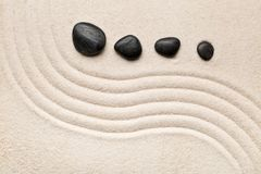 Zen sand and stone garden with raked curved lines. Simplicity, c. Zen sand and stone garden with curved raked lines. Simplicity, concentration or calmness Stock Photography