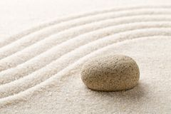 Zen sand and stone garden with raked curved lines. Simplicity, c. Zen sand and stone garden with raked curved lines with selective focus. Simplicity Royalty Free Stock Images
