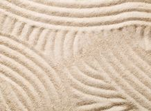Zen sand and stone garden with raked lines, curves and circles. Zen sand garden with raked curved lines. Simplicity, concentration or calmness abstract concept Stock Image