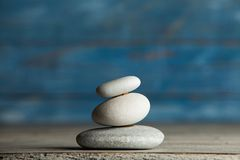 Zen sculpture. Harmony and balance, cairn, poise stones on wooden table.  stock images