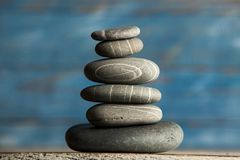 Zen sculpture. Harmony and balance, cairn, poise stones on wooden table.  royalty free stock photos