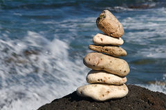 Zen Serenity Rocks. White coral rocks stacked by a meditating zen follower Royalty Free Stock Photography