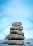 Zen spa stones with blue sky. In nature Royalty Free Stock Image
