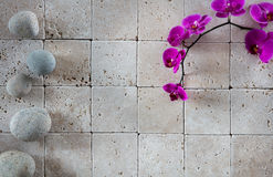 Zen spa wallpaper with pink orchids and feng shui pebbles Stock Photo