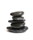 Zen Stack. Polished Zen Stones stacked five high over white background Stock Images