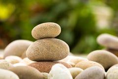 Zen stacked stones on nature background royalty free stock photo