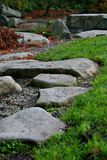 Zen stepping stones. In Japanese garden stock images