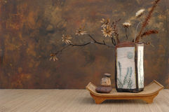 Zen Still Life. With Raku vase, natural dried flowers, and stones