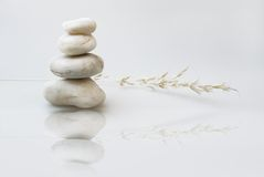 Zen still life, pebbles stacked, with grass Stock Photos