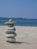 Zen stone. On the blue beach Royalty Free Stock Photo