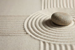 Zen stone. Stone on raked sand. Zen concept Stock Photography