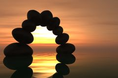 Zen stone arch in sunset Stock Photos