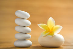 Zen stone and aromatic soap bar. Zen stone, aromatic soap bar with frangipani flower on bamboo mat Royalty Free Stock Photos