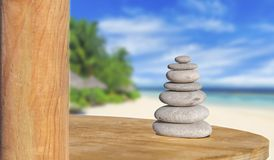 Zen stone like symbol of health and harmony with beach background. Stress stone Stock Photo