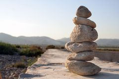 Zen Stone Meditation. Pile of pebbles in soft evening light Stock Photos