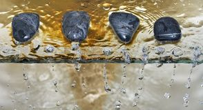 Zen stone pebble water drops Royalty Free Stock Photography