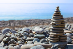 Zen stone pyramid with the Black sea in background Royalty Free Stock Photography