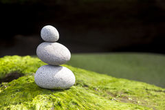 Zen stone rack tower on green surface Royalty Free Stock Photos