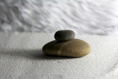 Zen stone on sand Royalty Free Stock Images