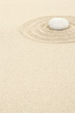Zen stone in sand with circles Stock Image