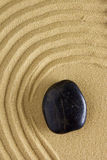 Zen stone in the sand Stock Image