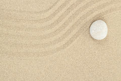 Zen stone in sand Stock Images