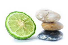 Zen Stone stacked and Kaffir Lime , spa concept Royalty Free Stock Photos
