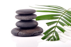 Zen stone tower. Zen stones with palm leaves on white Royalty Free Stock Image