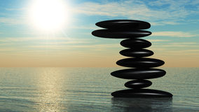 Zen stone on water Royalty Free Stock Images