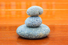Zen stone on wood Royalty Free Stock Images