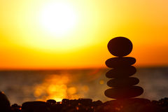 Zen stones. The sunset near the sea Royalty Free Stock Photography