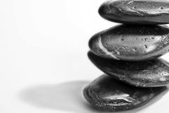 Zen stones. Balanced stack of four smooth black zen stones, isolated on white background Royalty Free Stock Image