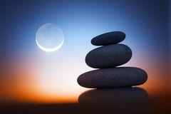 Zen stones. Over sunrise sky with moon Stock Image