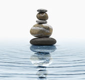 Zen stones. In blue water Stock Image