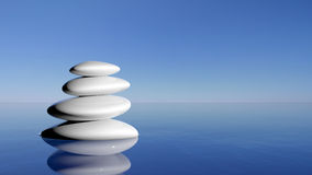 Zen stones. In the blue water Royalty Free Stock Photo