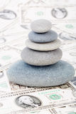 Zen stones. On money, dollars Royalty Free Stock Photos