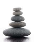 Zen stones. On a wooden table Stock Photography