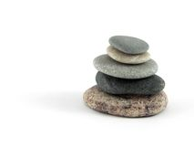 Zen stones. Pyramid of five stones on white background Stock Photography