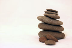Zen stones. Stone son a pile over white stock images