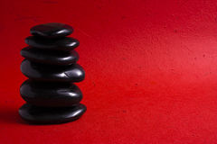 Zen Stones. Stack of zen stones on a red background Royalty Free Stock Photo