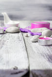 Zen stones aromatic candles wooden background Royalty Free Stock Photos