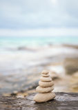 Zen stones, background the ocean for the perfect meditation Royalty Free Stock Image