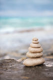 Zen stones, background the ocean for the perfect meditation Stock Photo