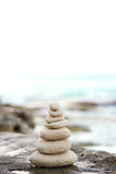 Zen stones, background ocean, see, place  for the perfect meditation Royalty Free Stock Image