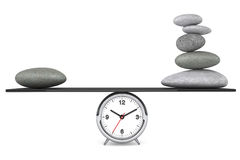 Zen Stones balanced on a clock Royalty Free Stock Photography