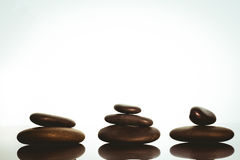 Zen stones balancing on white background Stock Image