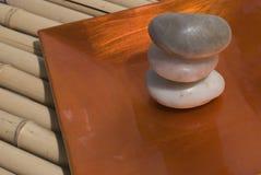Zen stones and bamboo. Zen stones on bamboo background meditation concept royalty free stock photos