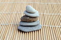 Zen stones on bamboo background Royalty Free Stock Images